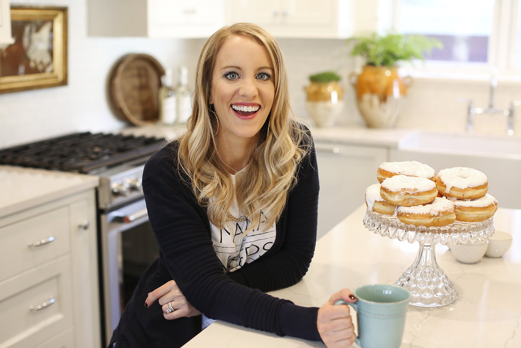 jen biswas enjoying coffee and donuts in a JKath remodeled kitchen in St Paul Minnesota