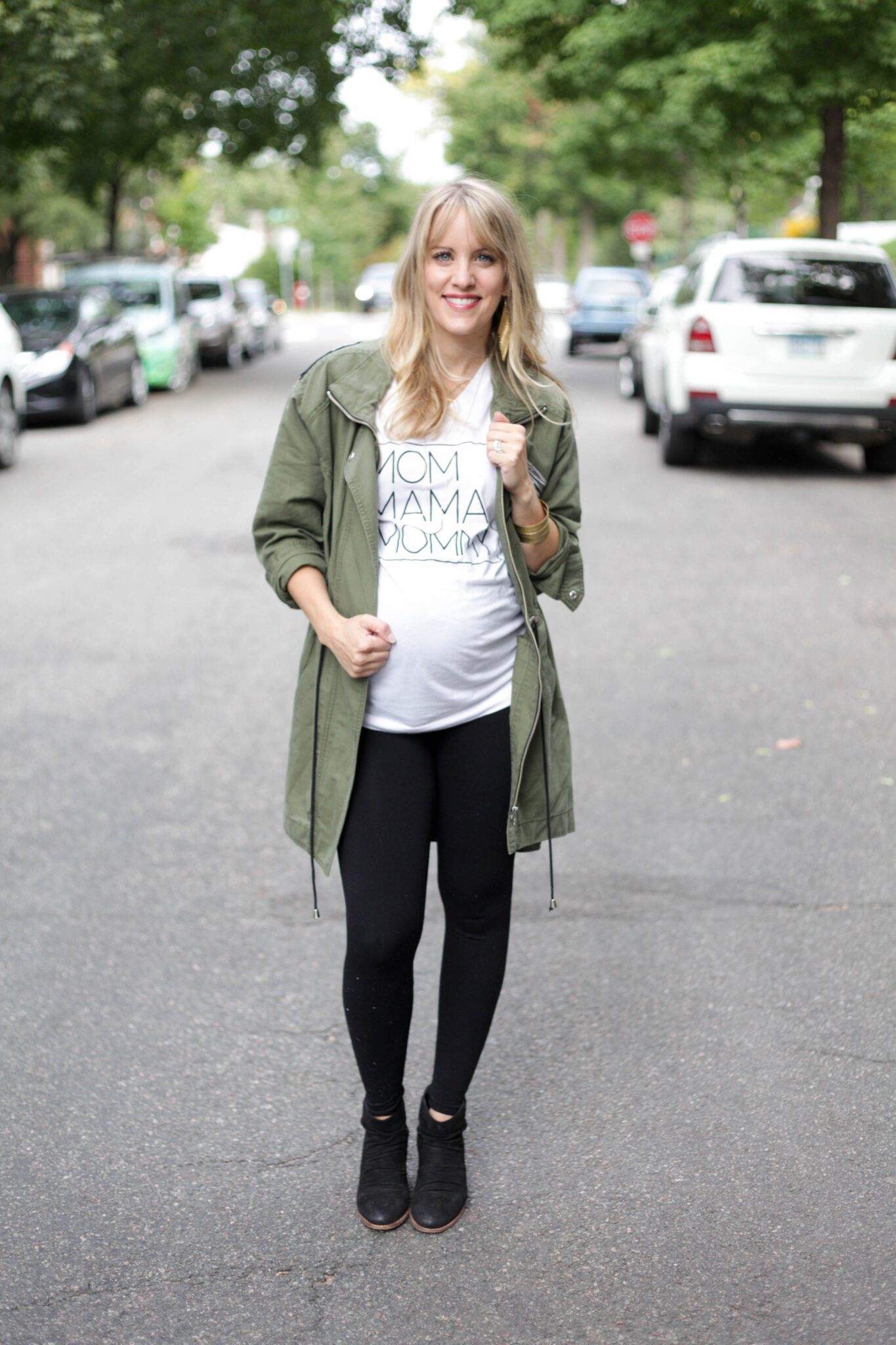 fall fashion for moms featuring graphic tees + army green trench coat