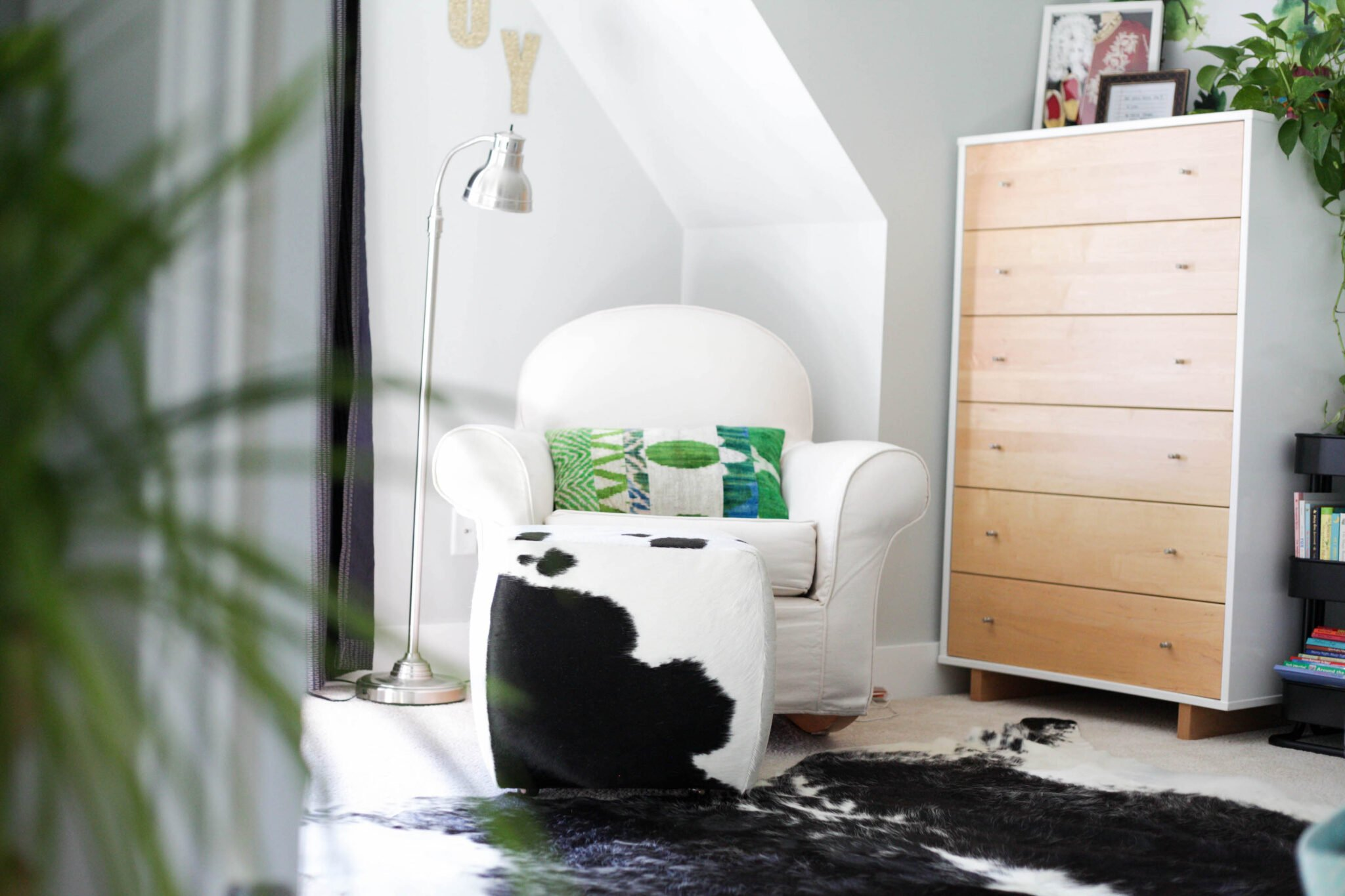 nursery ideas for boys - modern kids room with cowhide rug and ottoman