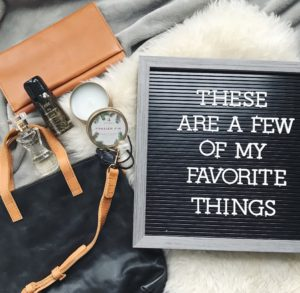 women's favorite things - perfume, leather, oribe and letterboard