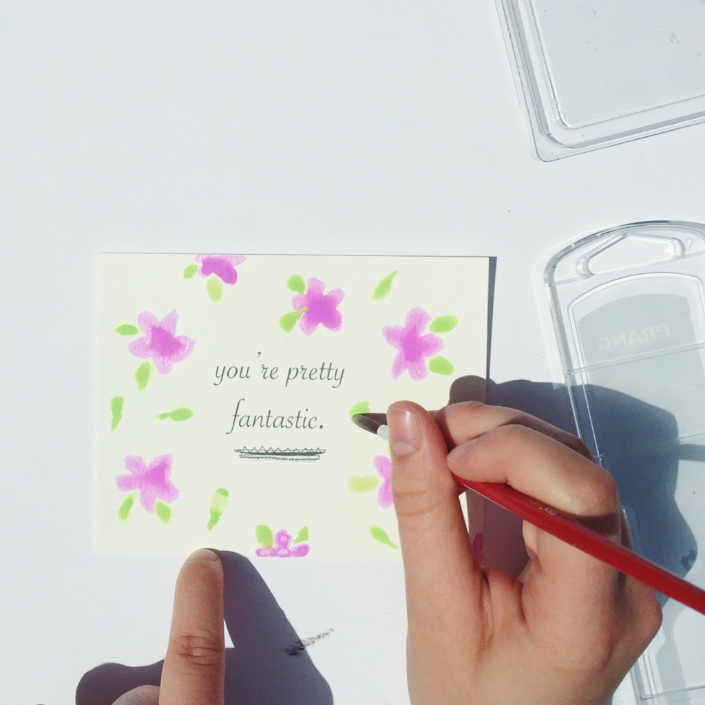 painting a postcard with purple flowers