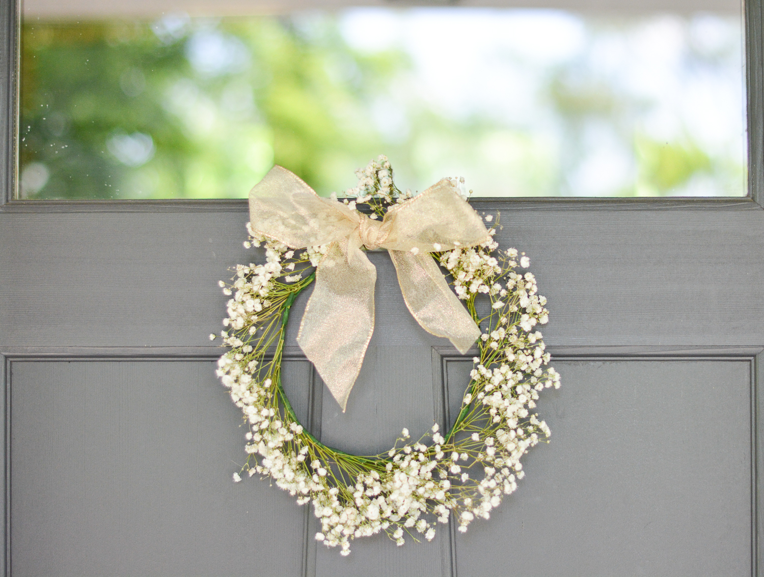 baby's breath wreath with gold bow