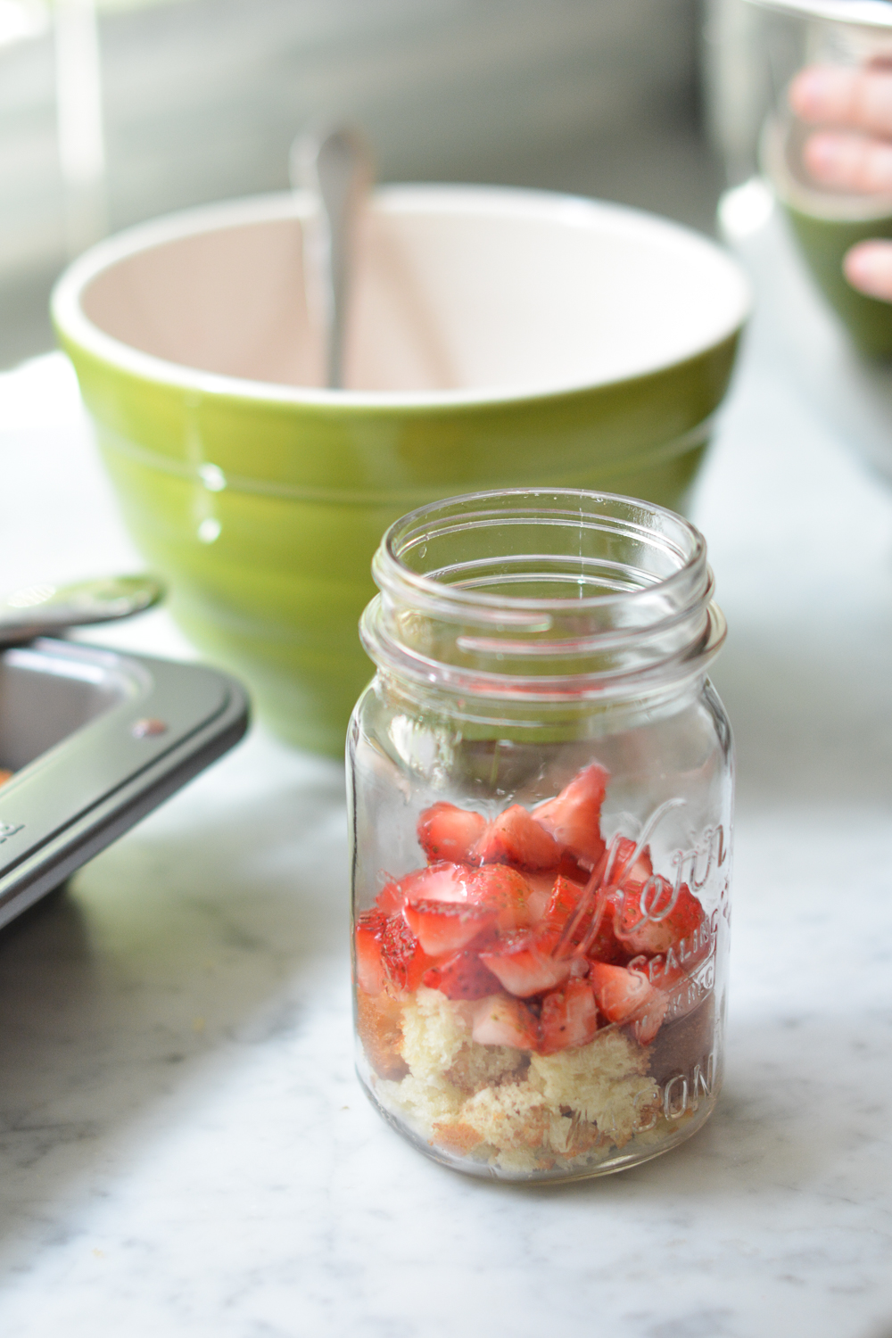 layering the strawberries and cake