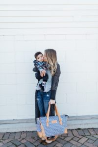 Baby kisses carrying a blue and tan organized diaper bag by minneapolis brand austin fowler