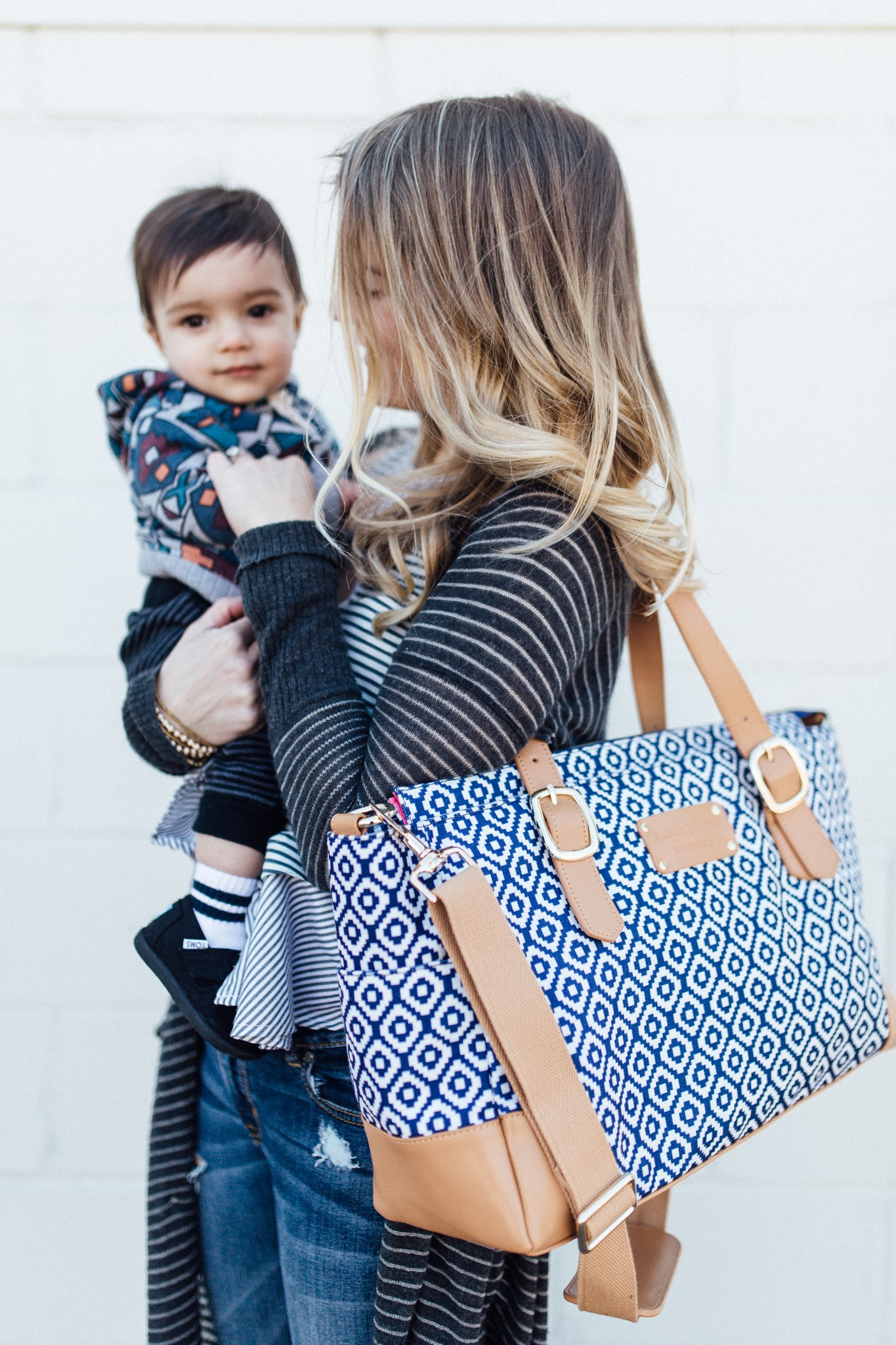 carrying my blue and tan austin fowler diaper bag