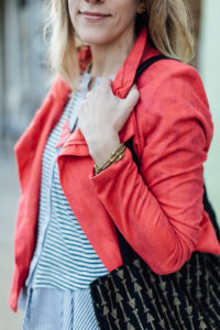 Pink velvet jacket with gold wrap bracelet.