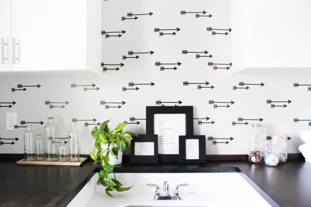 Laundry room decor featuring a faux arrow DIY wallpaper accent wall.