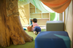 Crawling in the tree fort in the minnesota children's museum toddler section