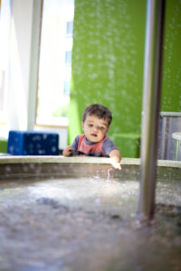 Playing in the water at the minnesota children's museum toddler section