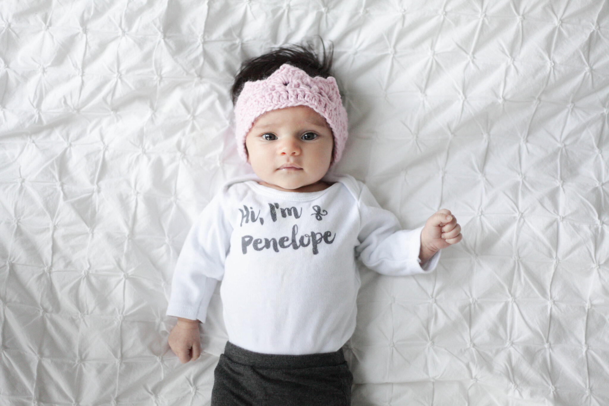 personalized baby onesie with knit pink crown