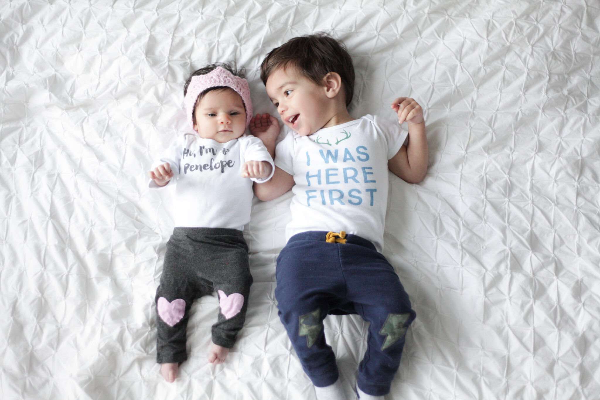 adorable happy babies in personalized baby onesie