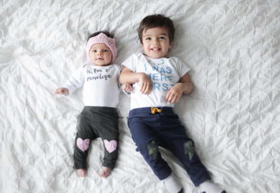 personalized baby onesie on siblings that are 2 under 2