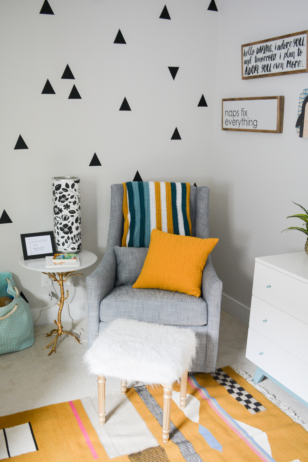 modern gender neutral nursery with west elm chair and triangle wall