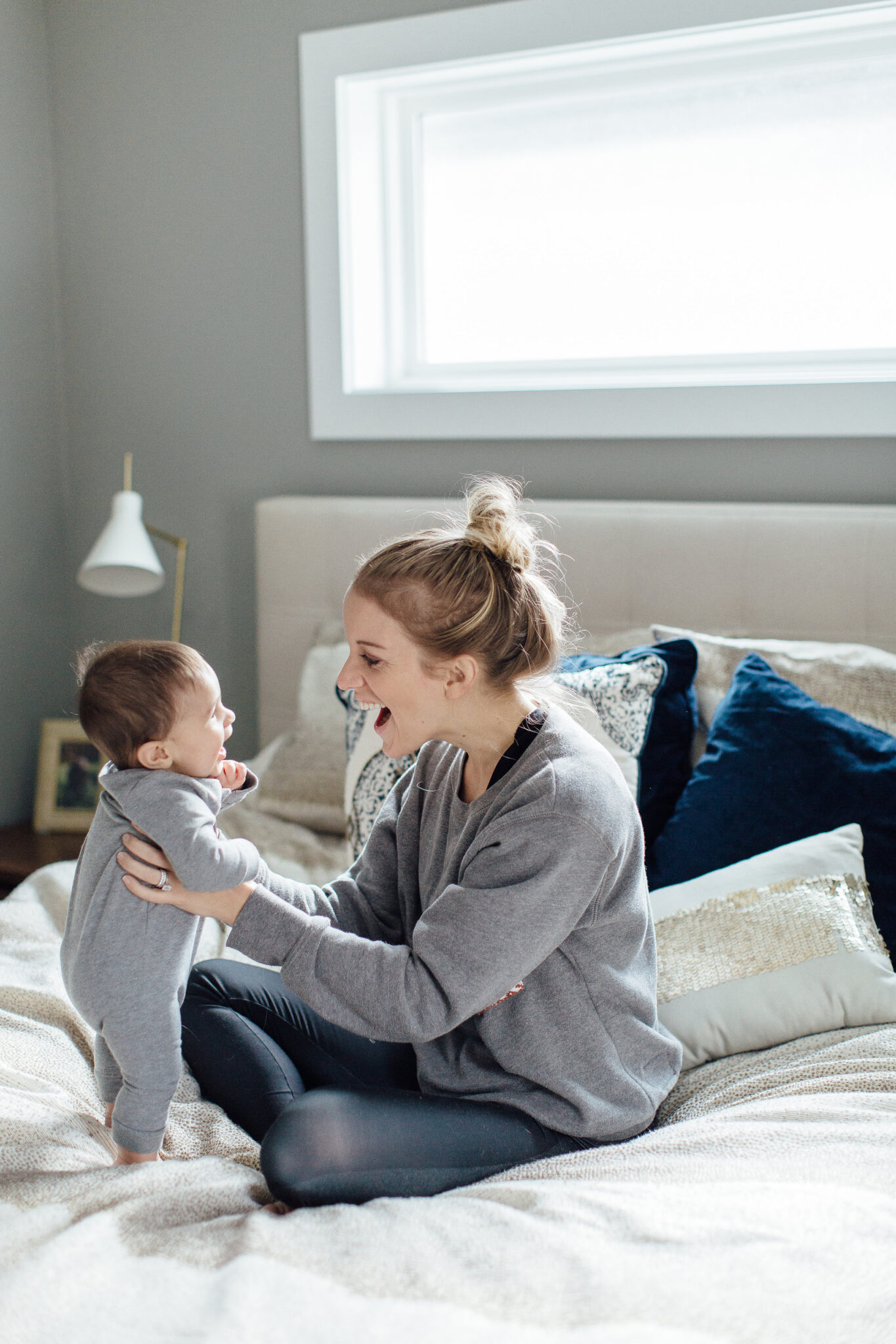 first time mom tips - Mom and son casual bedroom photo shoot.