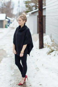 Snowy day wearing black outfit, black skinny jeans, black poncho and maroon heels