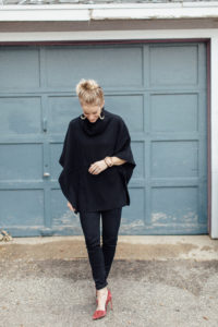 All black outfit, black skinny jeans, black poncho and maroon heels