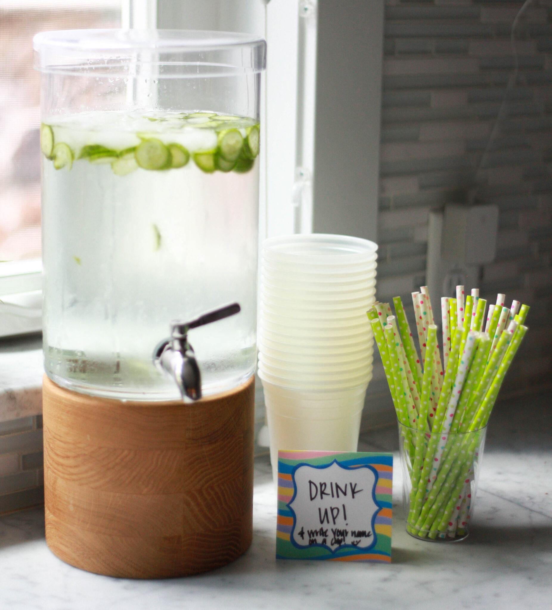 First birthday drink station with polka dot straws.