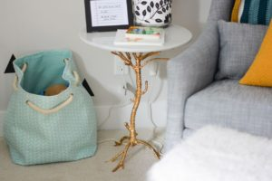 Gold and marble tree table for baby nursery.