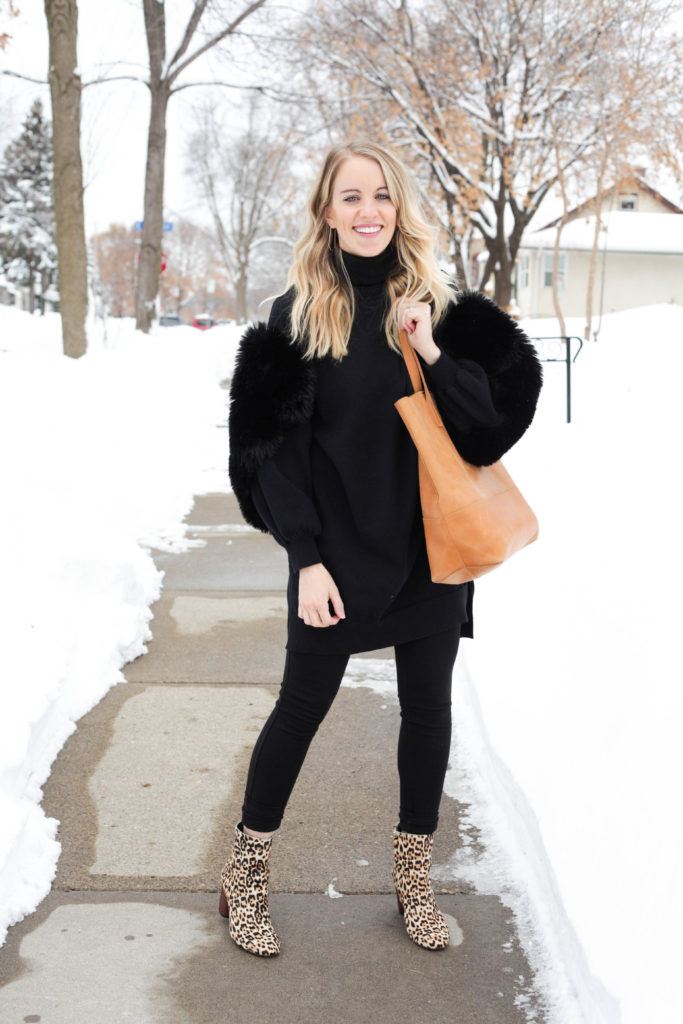 Unique winter outfit with furry sleeve sweater, ethically made able mamuye tote and leopard boots.
