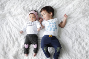 Customized baby onesies from Hi Little One paired with knit baby crown and knee patched pants.