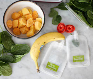 Sharing homemade baby food puree food from a pouch made in an infantino squeeze station.