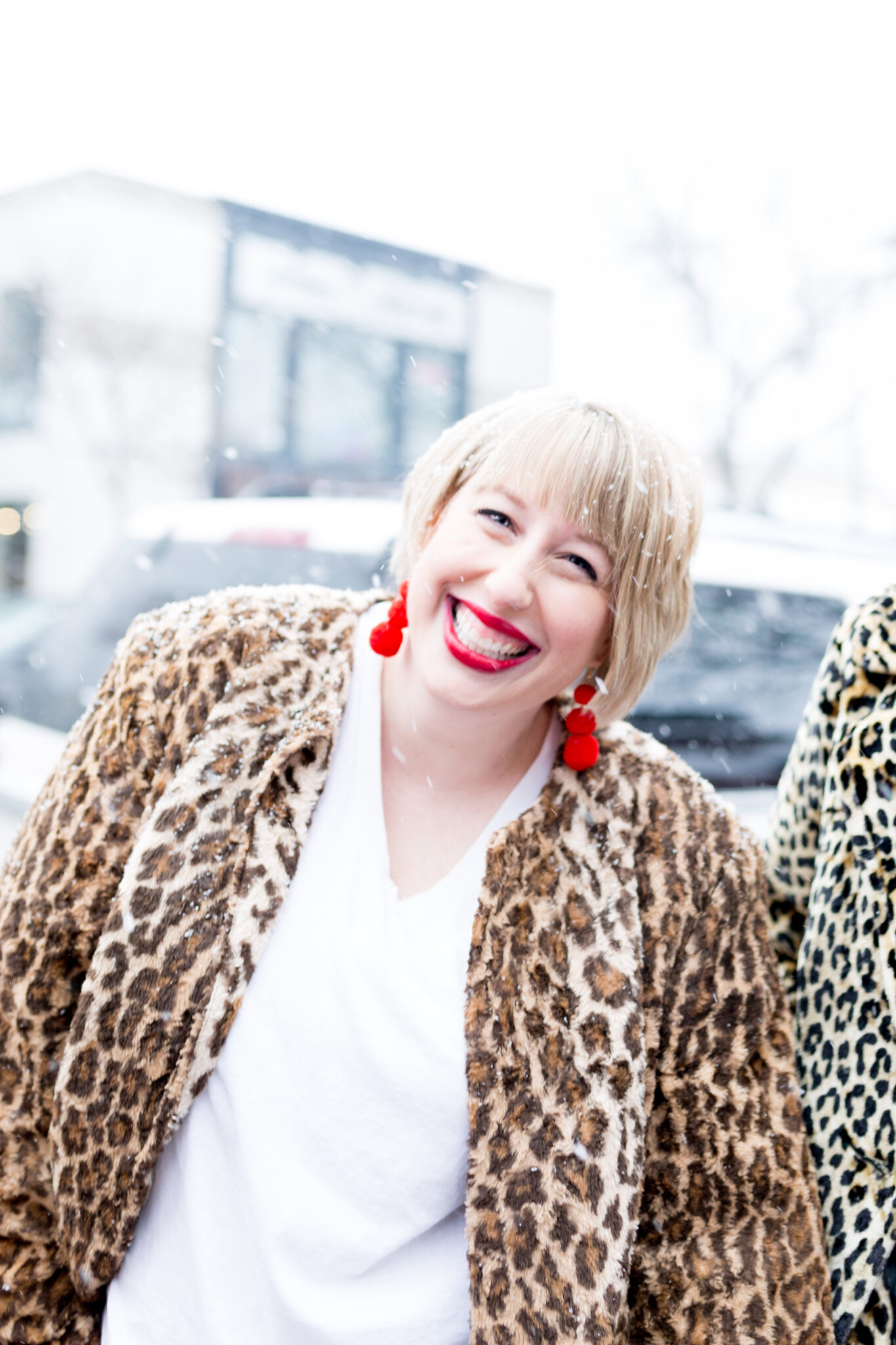 mix like a mother cofounder Michelle Raven rocking red earrings and a leopard jacket