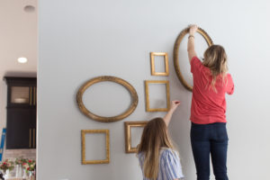 Decorating a gold frame gallery wall with vintage frames.