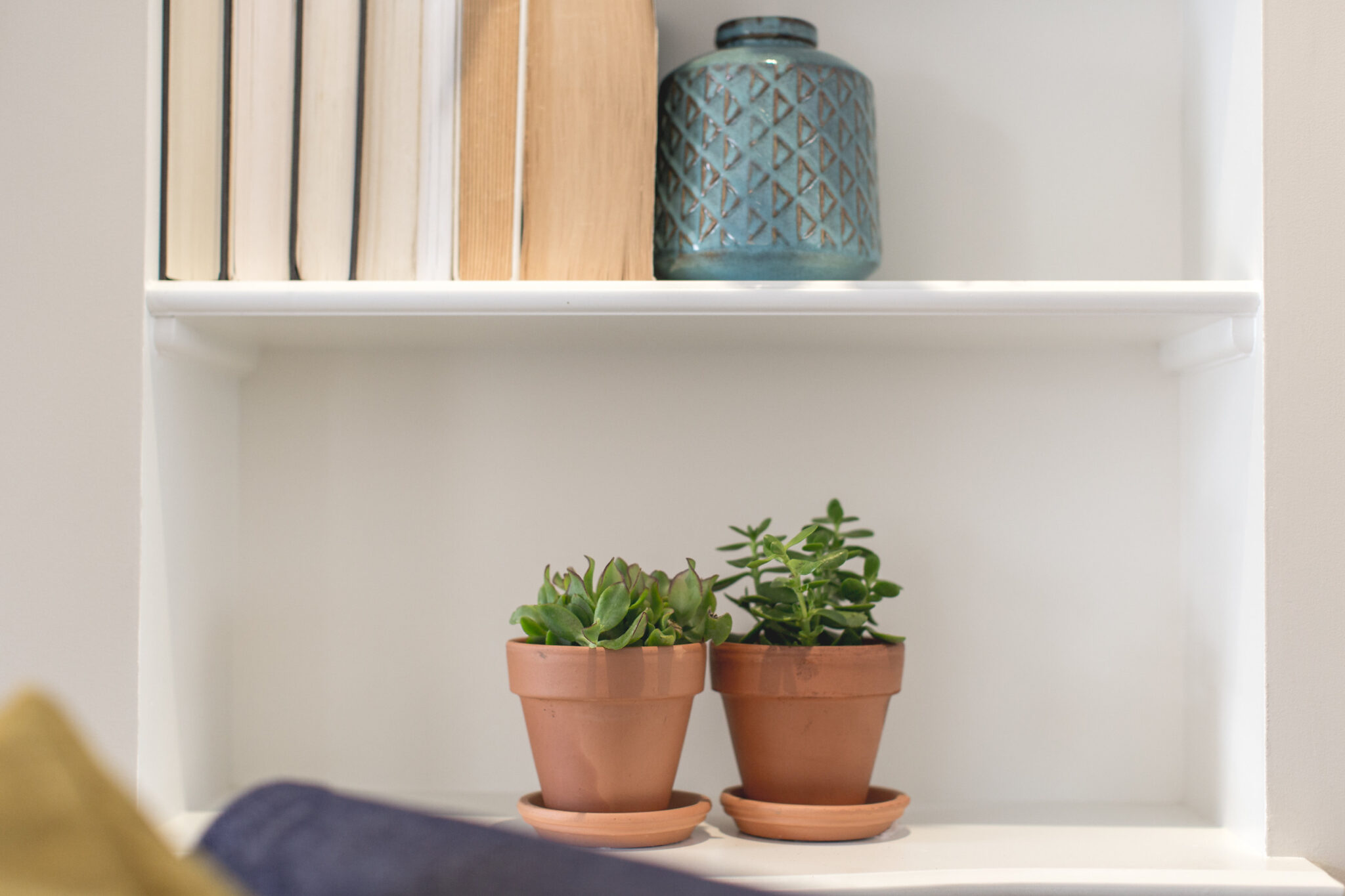 terra cotta pots and books with binding backwards