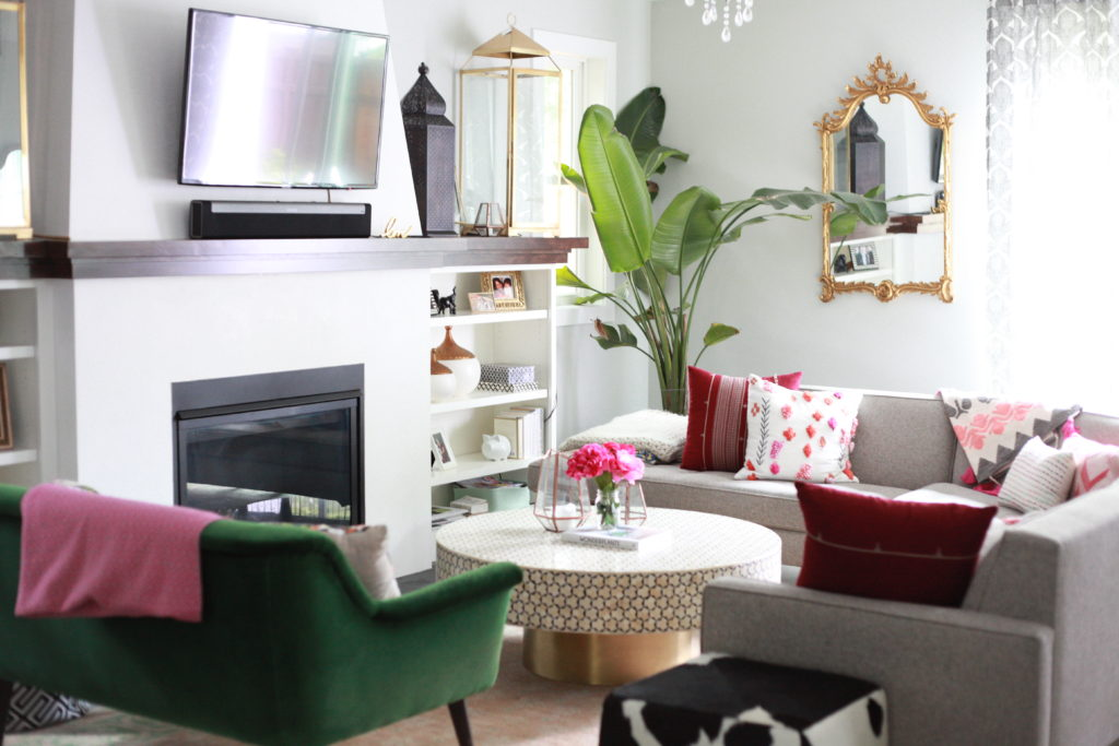 light, bright living room with anthropologie coffee table and room and board couch.