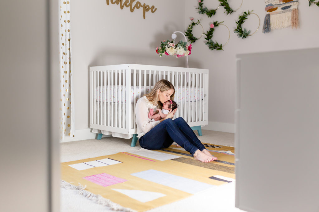 mom and daughter in boho chic nursery