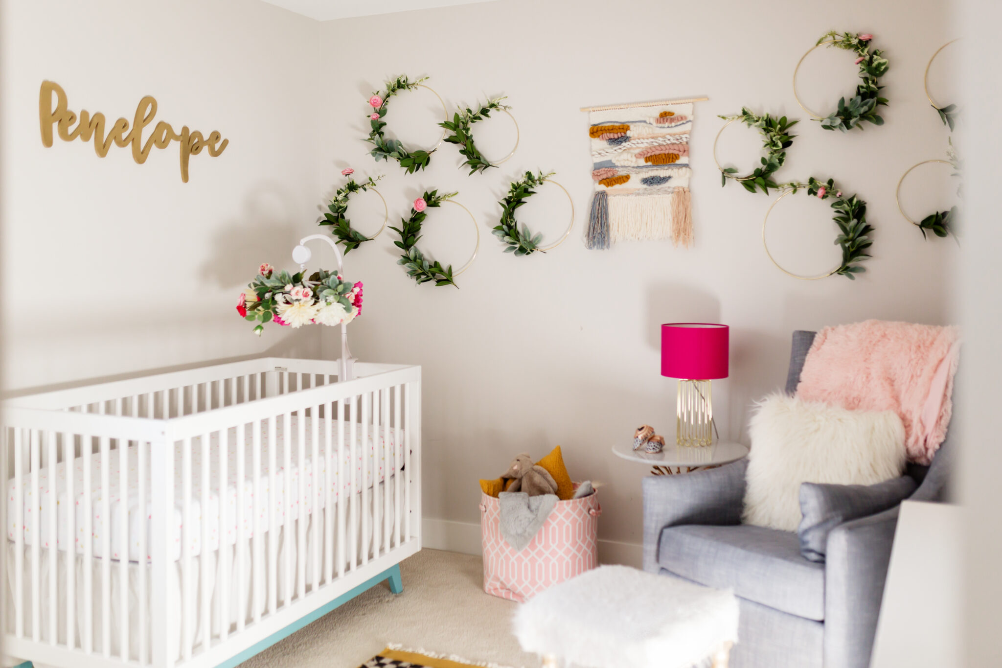 girly chic nursery with greens and floral
