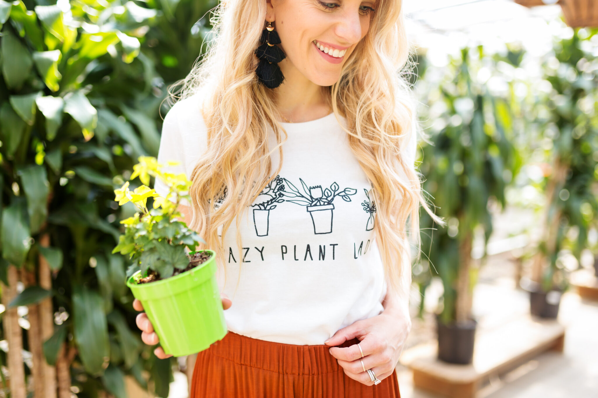 crazy plant lady graphic tee with black tassel earrings