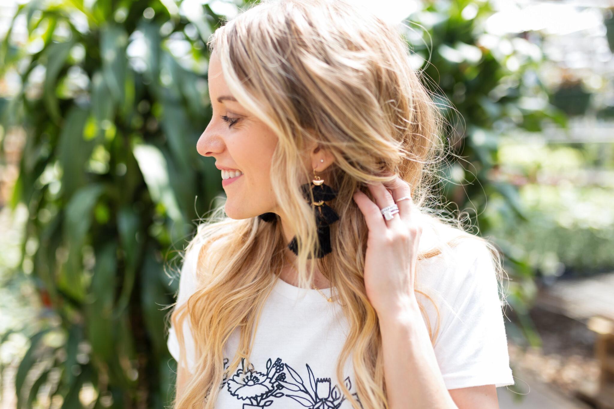 black tassel earrings and long beach waves