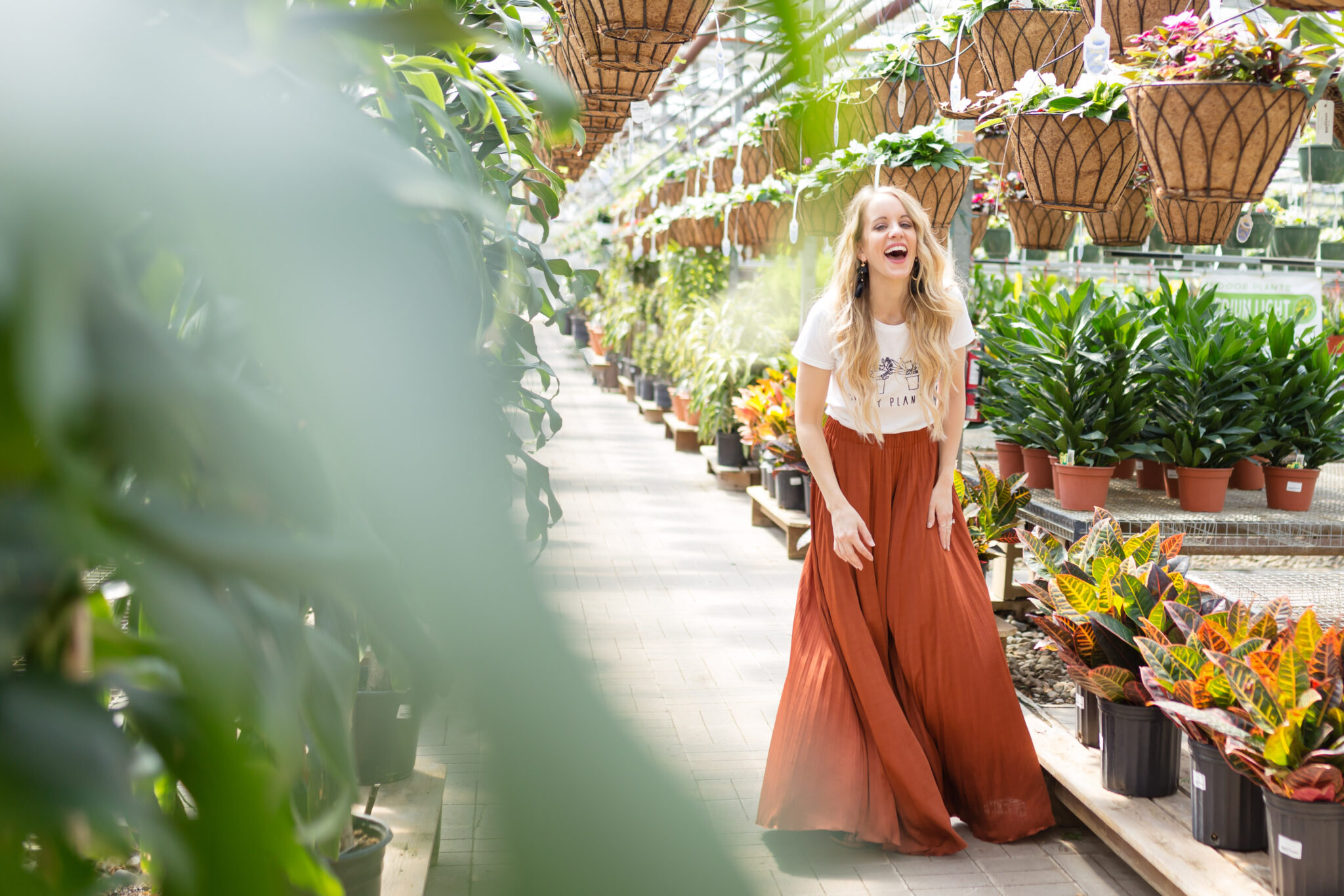 crazy plant lady graphic tee with elizabeth and james burnt orange pleated pants and long beachy waves