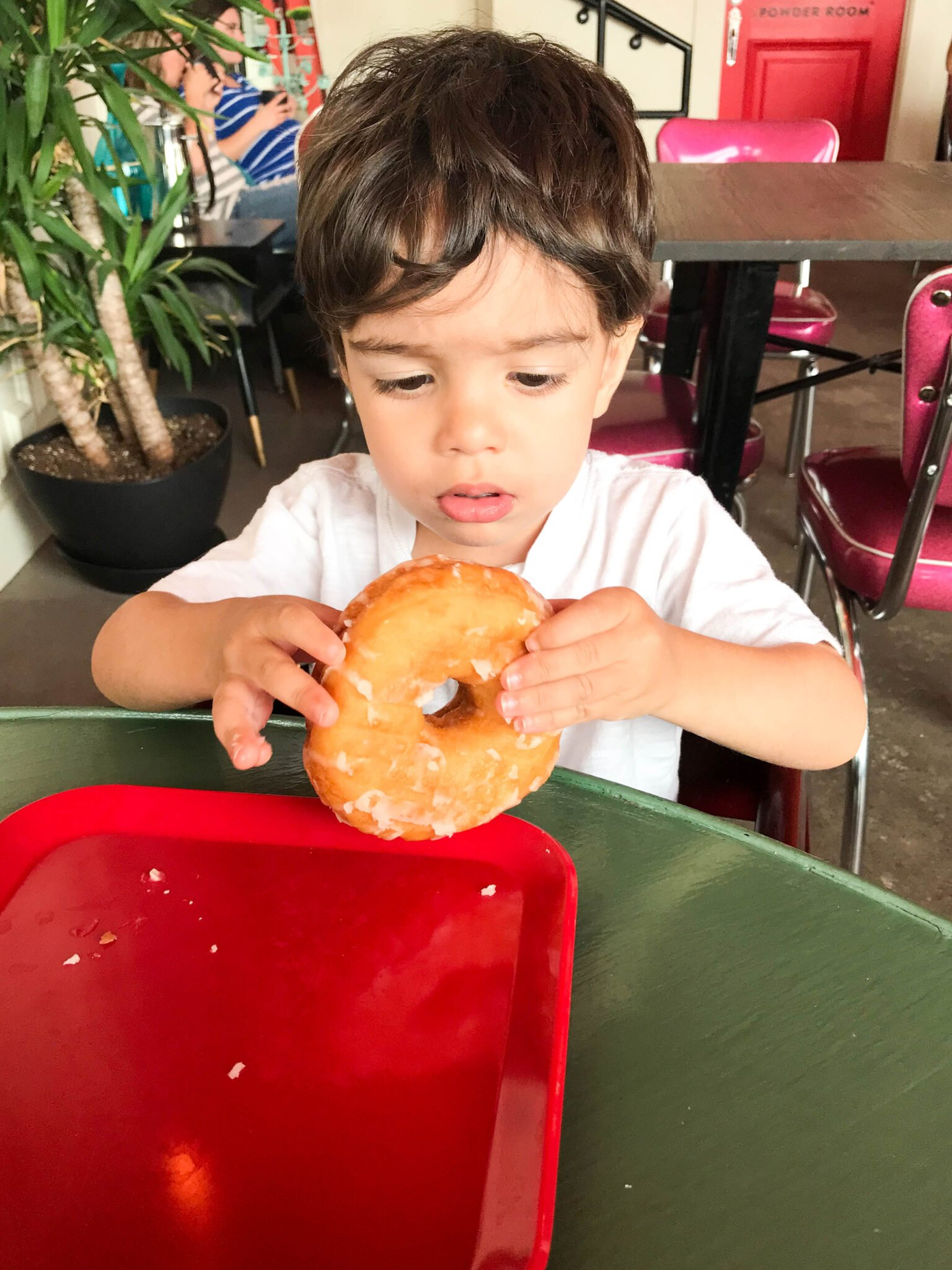toddler with donut - things to do on a 2 year old's birthday