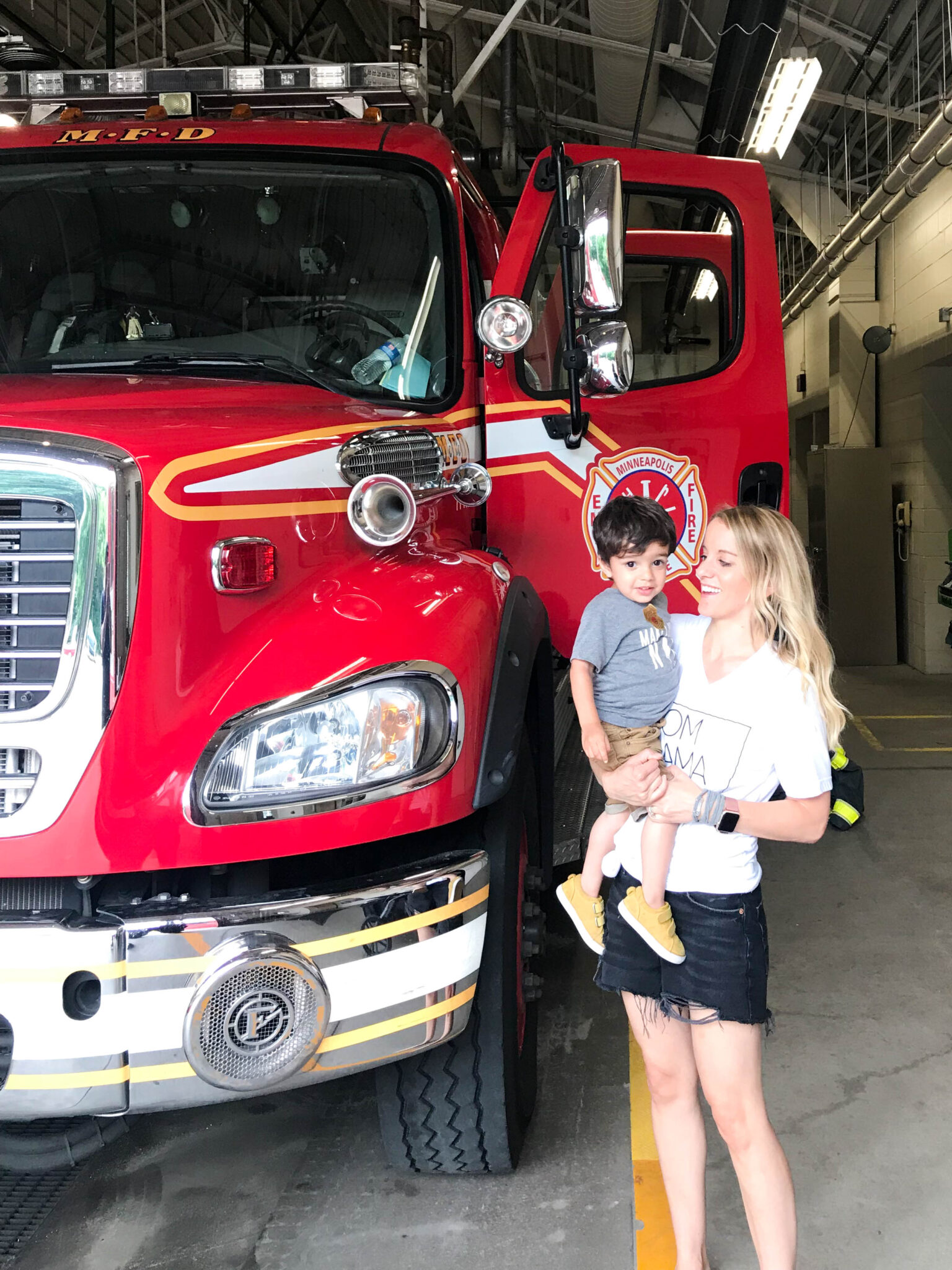 toddler with fire truck - things to do on a 2 year old's birthday