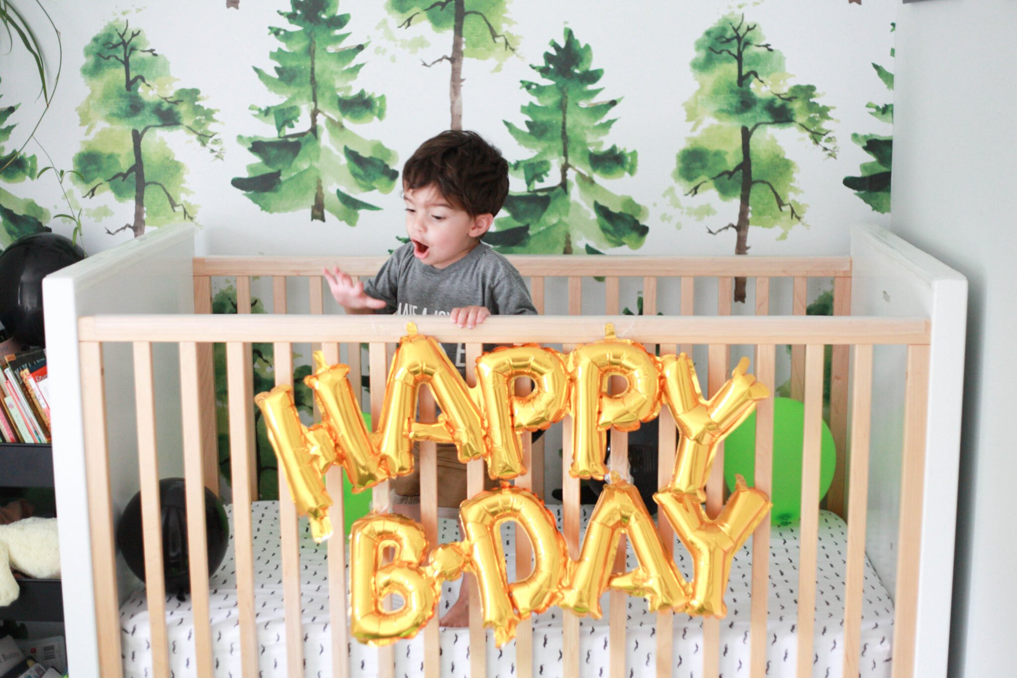 Balloons in the crib is a great way to begin celebrating your 2 year old's birthday!
