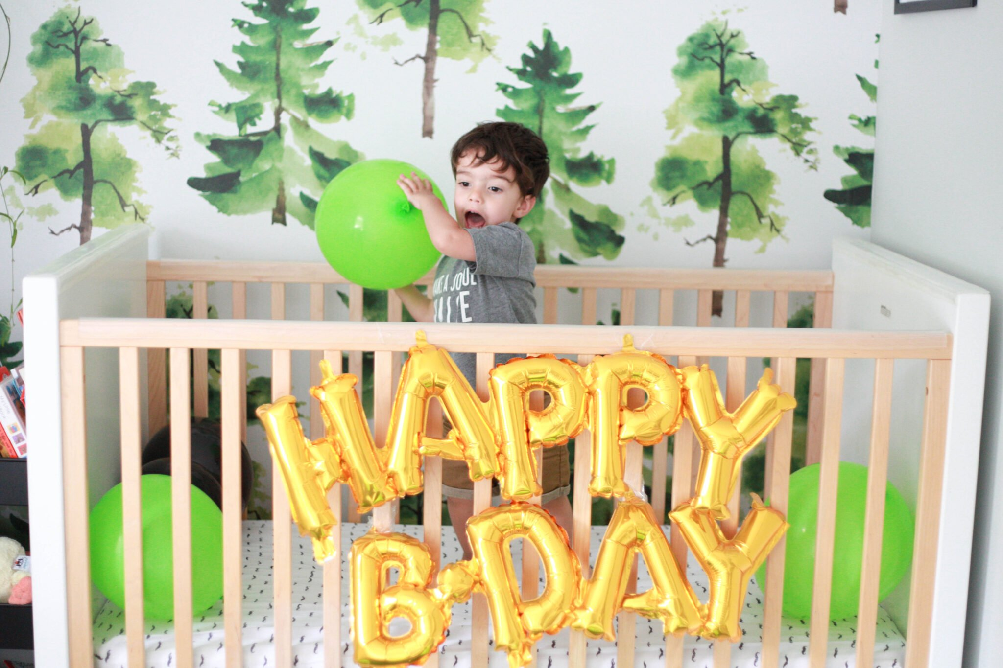 Start celebrating your two year old's birthday by filling their crib with balloons!