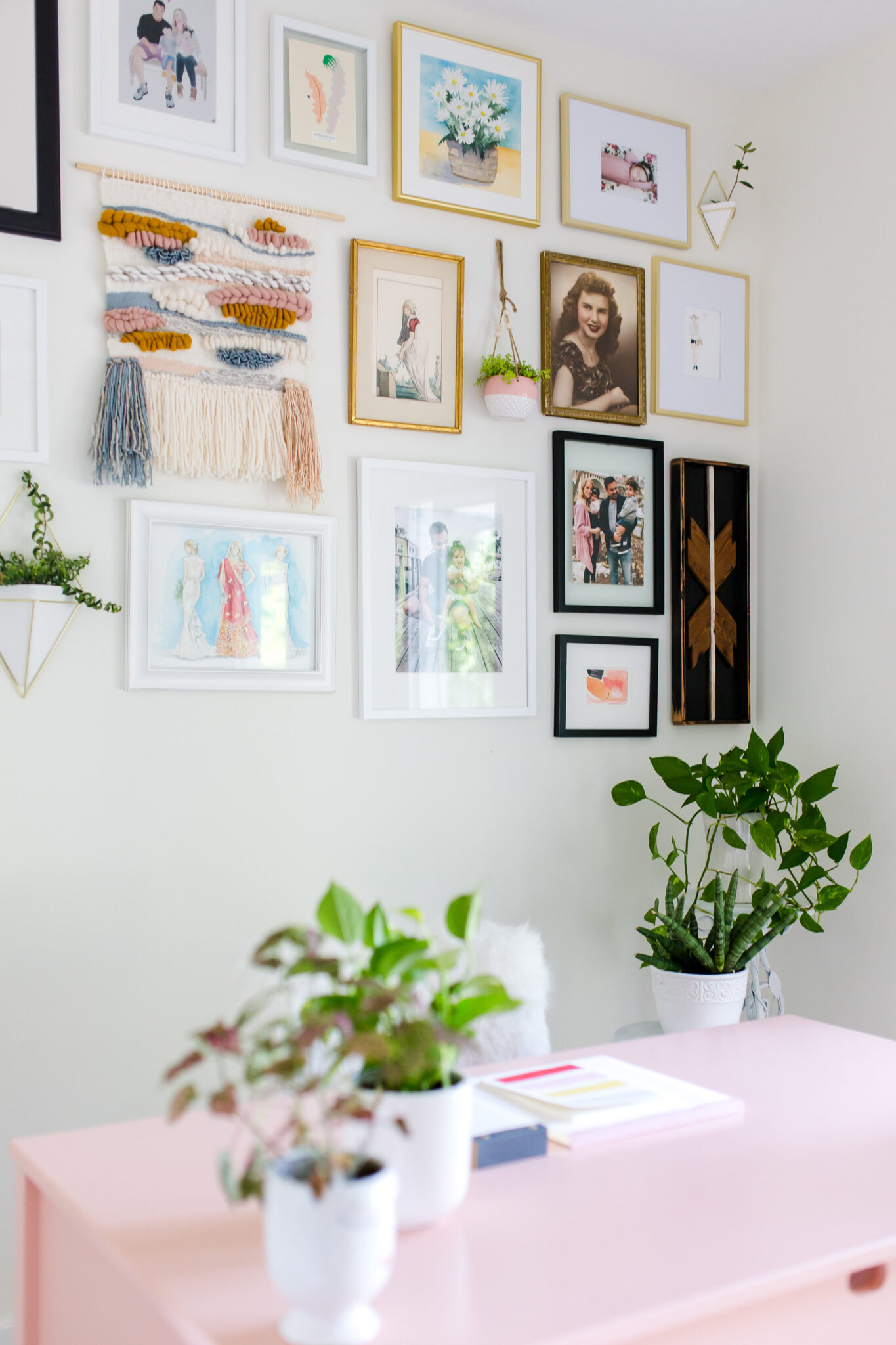 gallery wall with weave, reclaimed wood art and hanging plants
