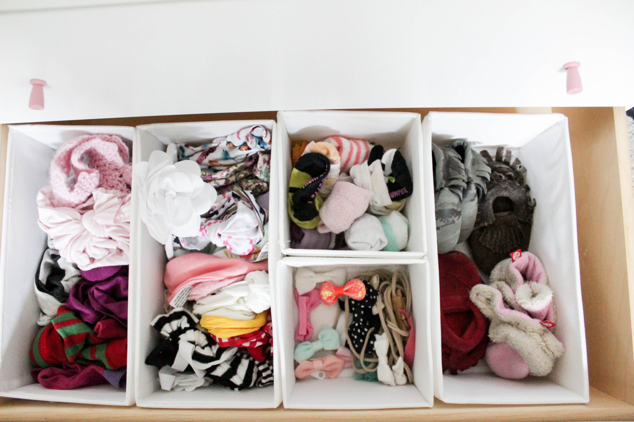 organizing baby's closet - dresser drawers with socks, shoes, bows