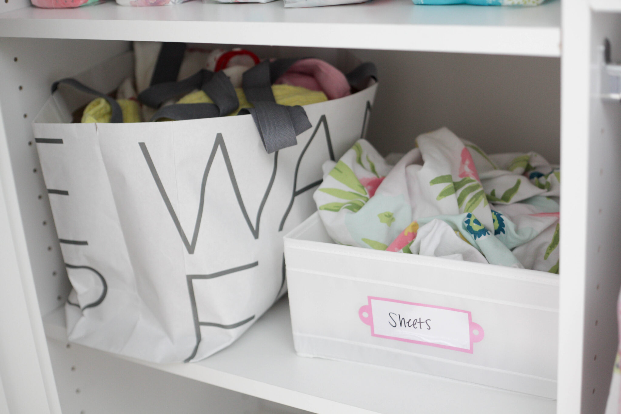 organizing baby's closet - sheets and my old clothes