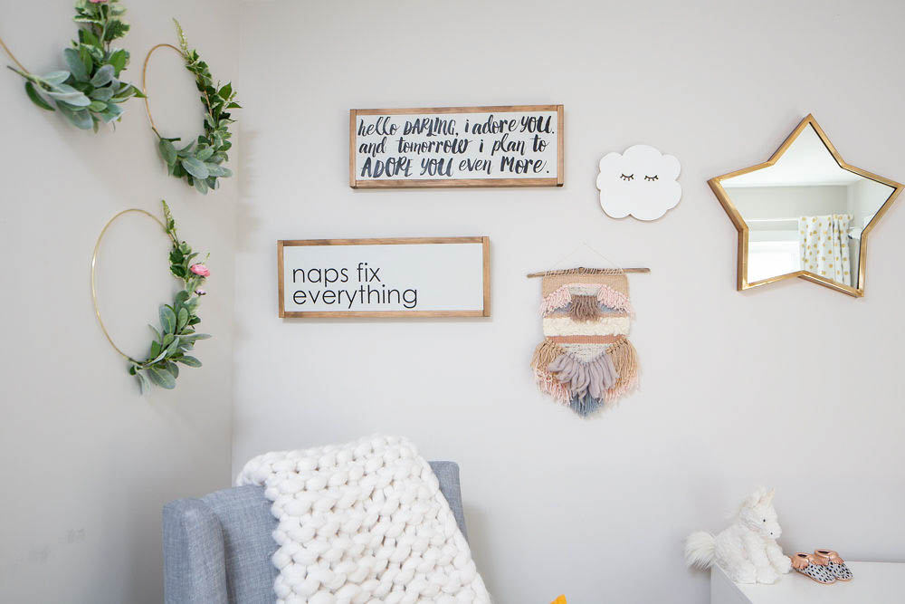 Nursery gallery wall with cloud, weave and star mirror