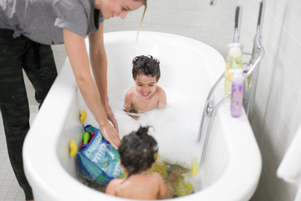Utilize the bath for crabby kids - a favorite mom hack!
