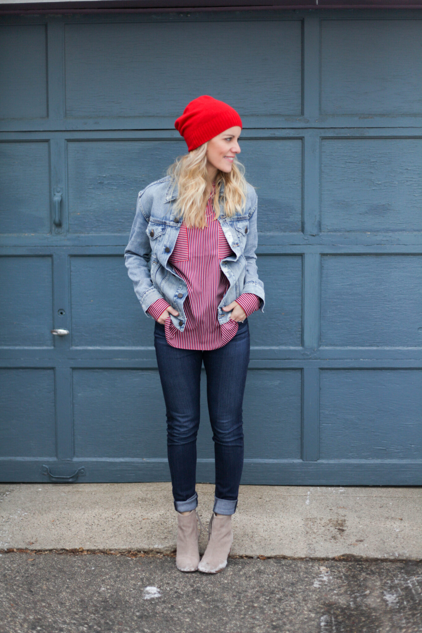 Denim on denim outfit with a red hat- the Canadian tuxedo!