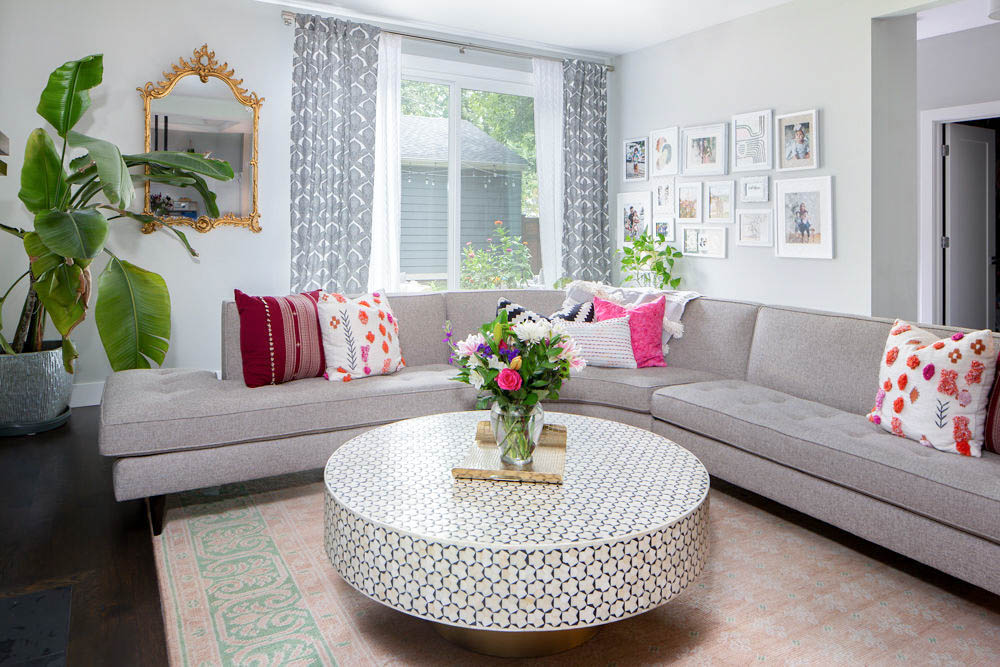 Learn how to style your living room in 5 simple steps! Beautiful styled living room with round coffee table,, white frame gallery wall and gold accents. #livingroom #neutrallivingroom #pinklivingroom