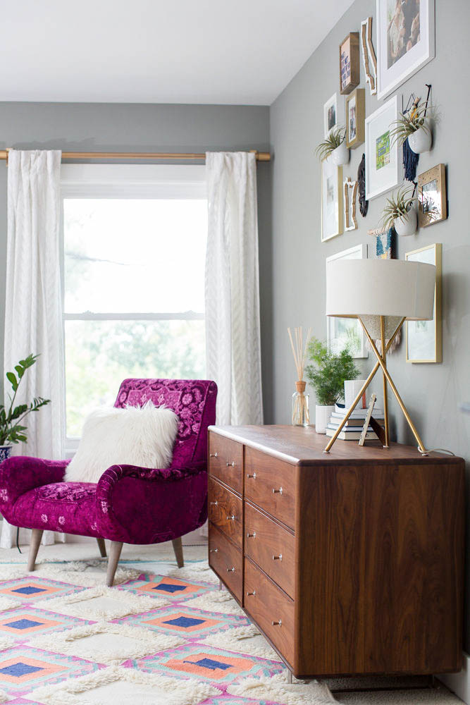 How to Decorate Your Bedroom - Room and Board dresser, gallery wall and fuchsia arm chair from Anthropologie