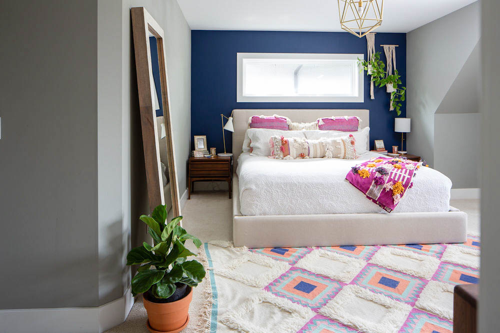 How to Decorate Your Bedroom - Navy accent wall, hanging plants and Anthropologie bedding