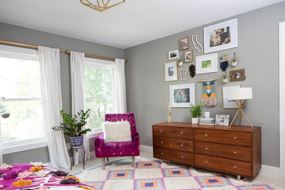Bright Master Bedroom - Room and Board dresser, gallery wall and fuchsia arm chair from Anthropologie