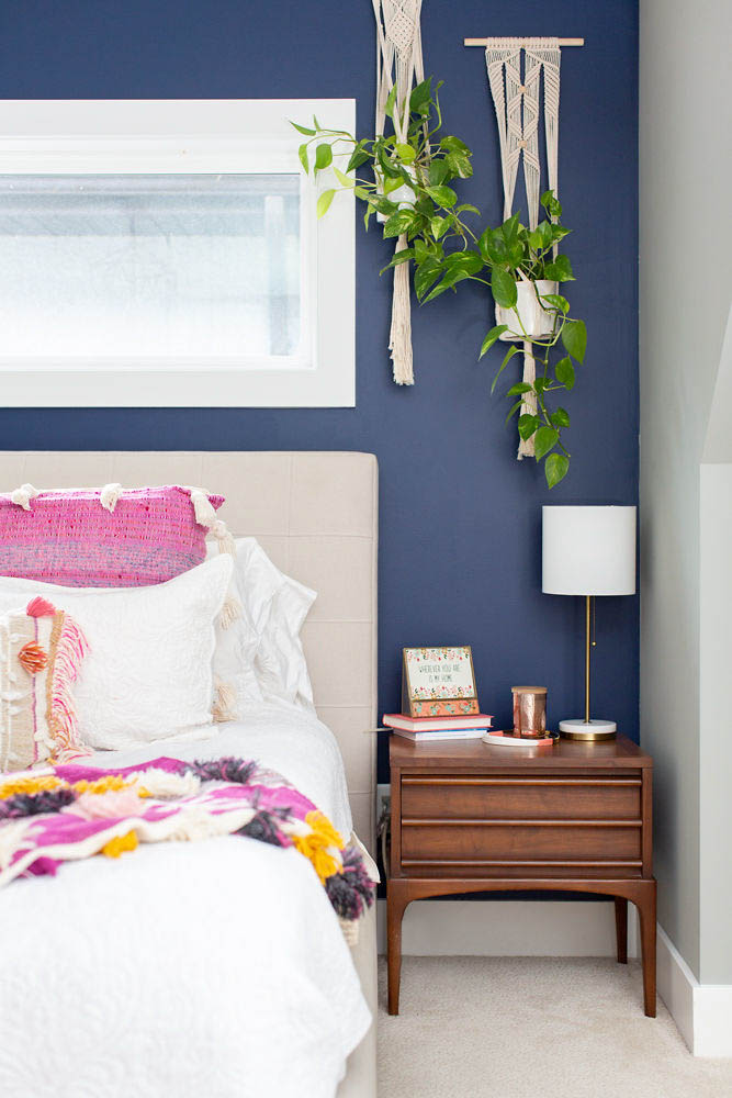 Navy Accent Wall Master Bedroom with Hanging Plants and Anthropologie bedding