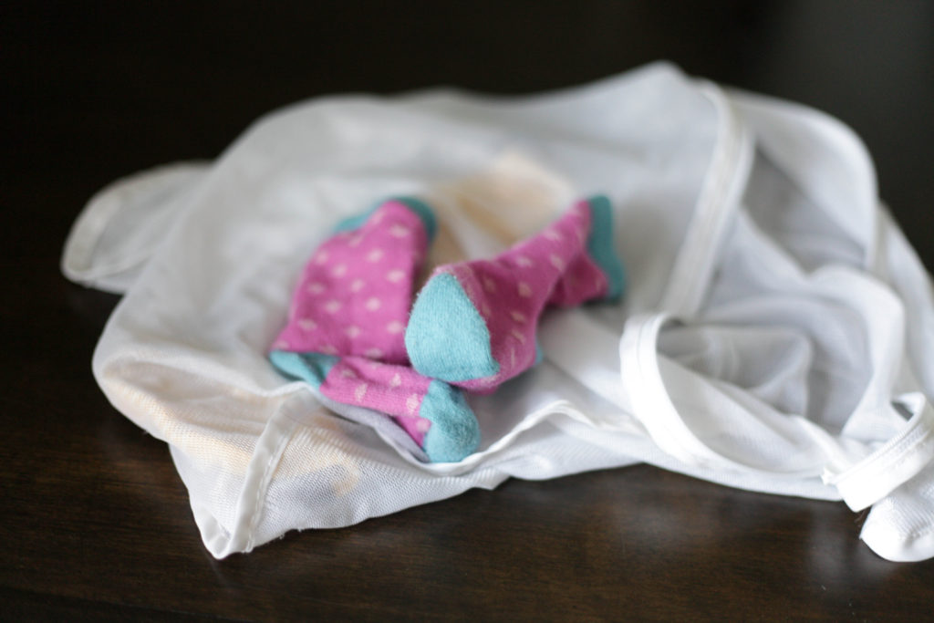 7 Mom Hacks - Put those little socks in a mesh zippered bag for easy folding! #momhack #laundry #momtip
